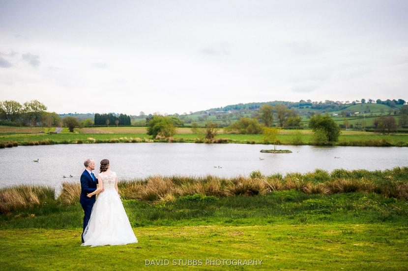 newly married couple by pond