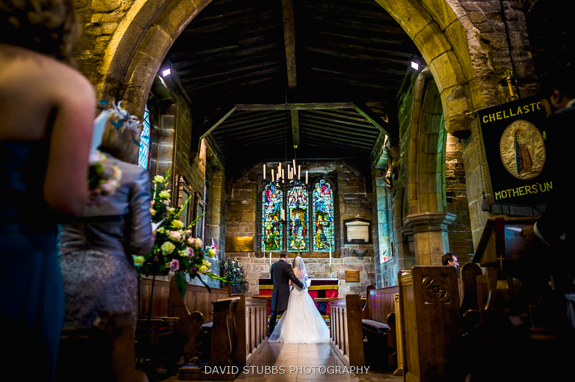 married couple under stained glass window