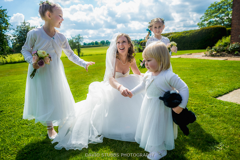 bride laughing with kids