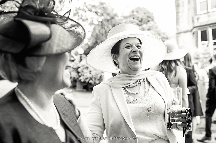 women in hats laughing