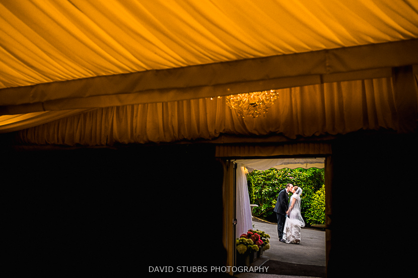 man and wife outside marquee