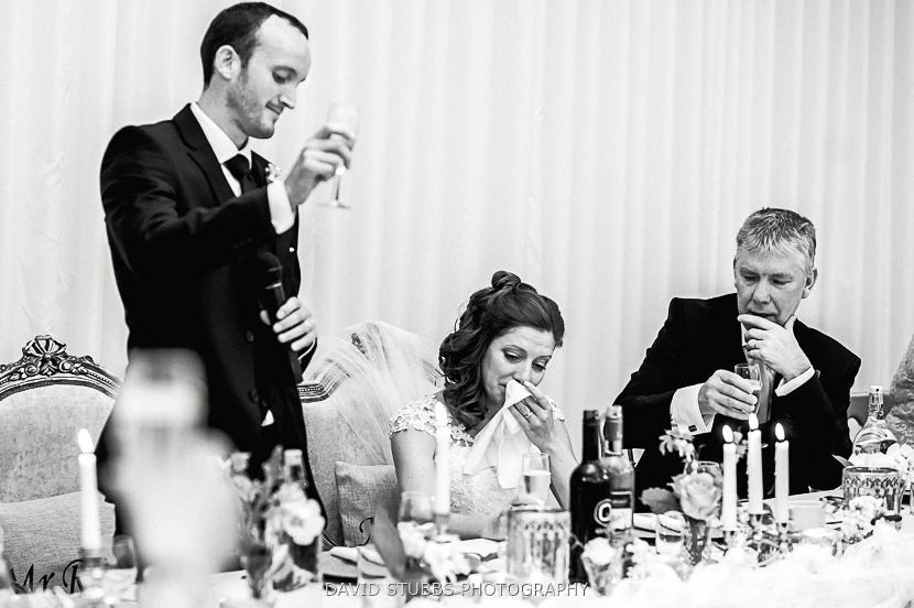 groom doing toast