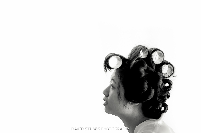 woman with curlers in