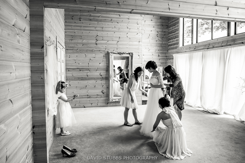 woman putting white dress on styal lodge