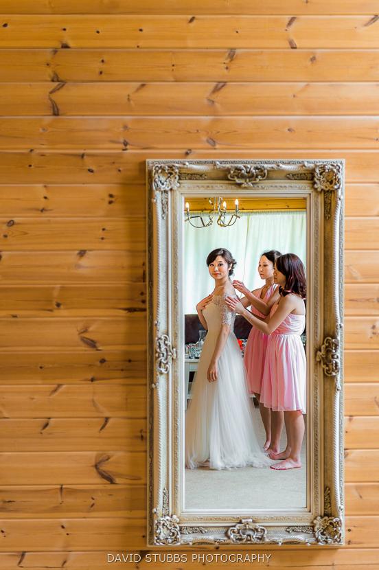bride reflection in mirror styal lodge