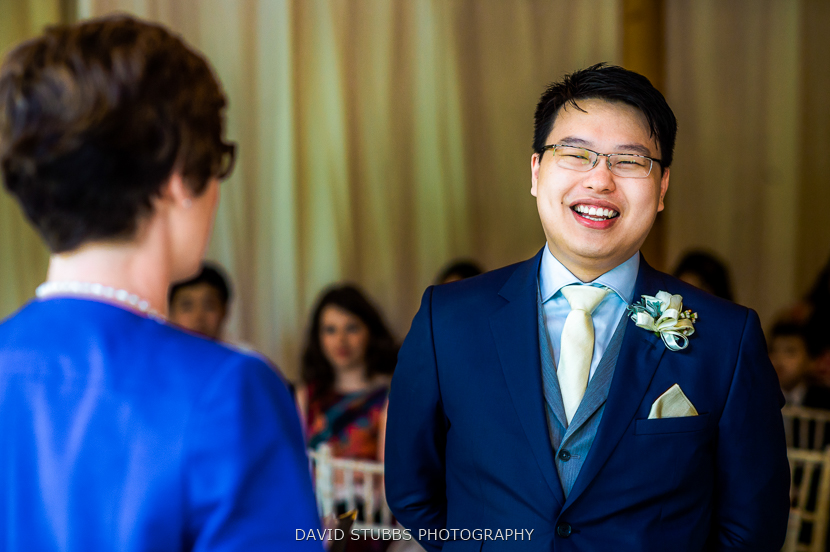 groom laughing colour photo