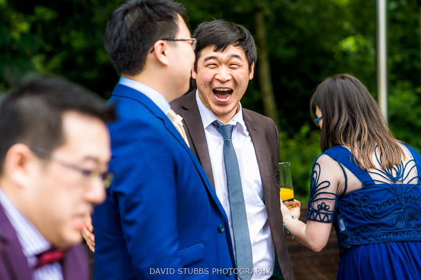 man laughing with groom
