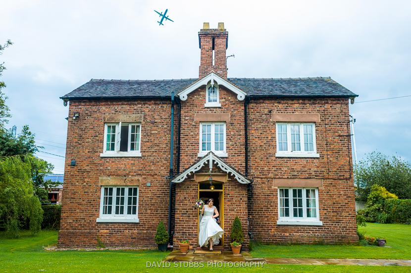 plane flying over cottage