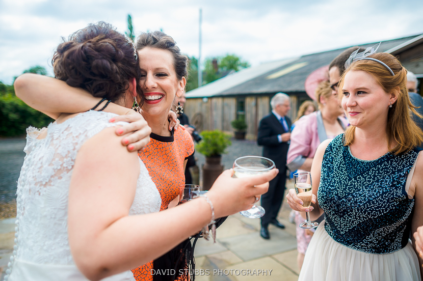 friends hugging bride