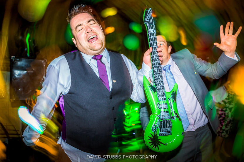 man with inflatable guitar