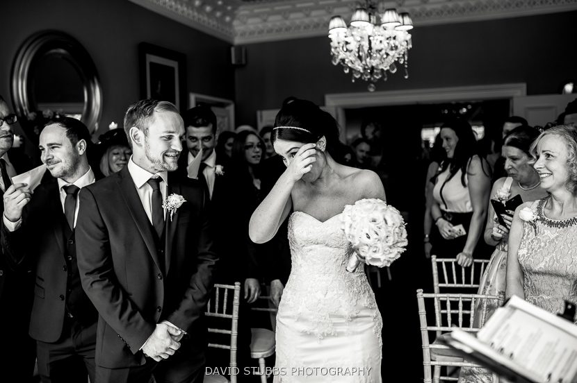 bride wiping tear black and white