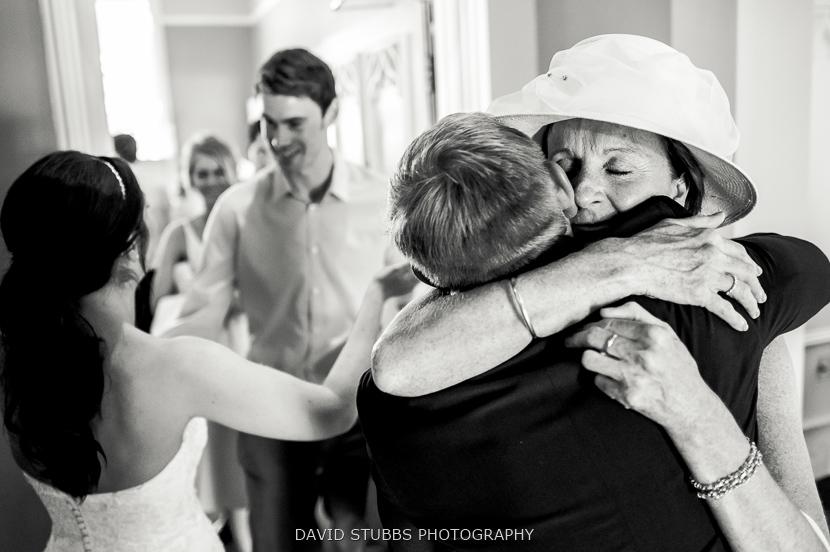 groom hugging black and white
