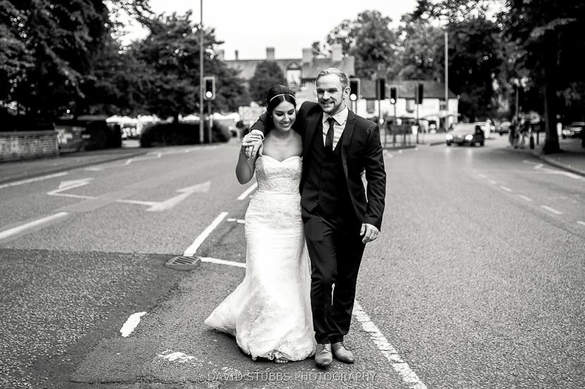 married couple walking in road