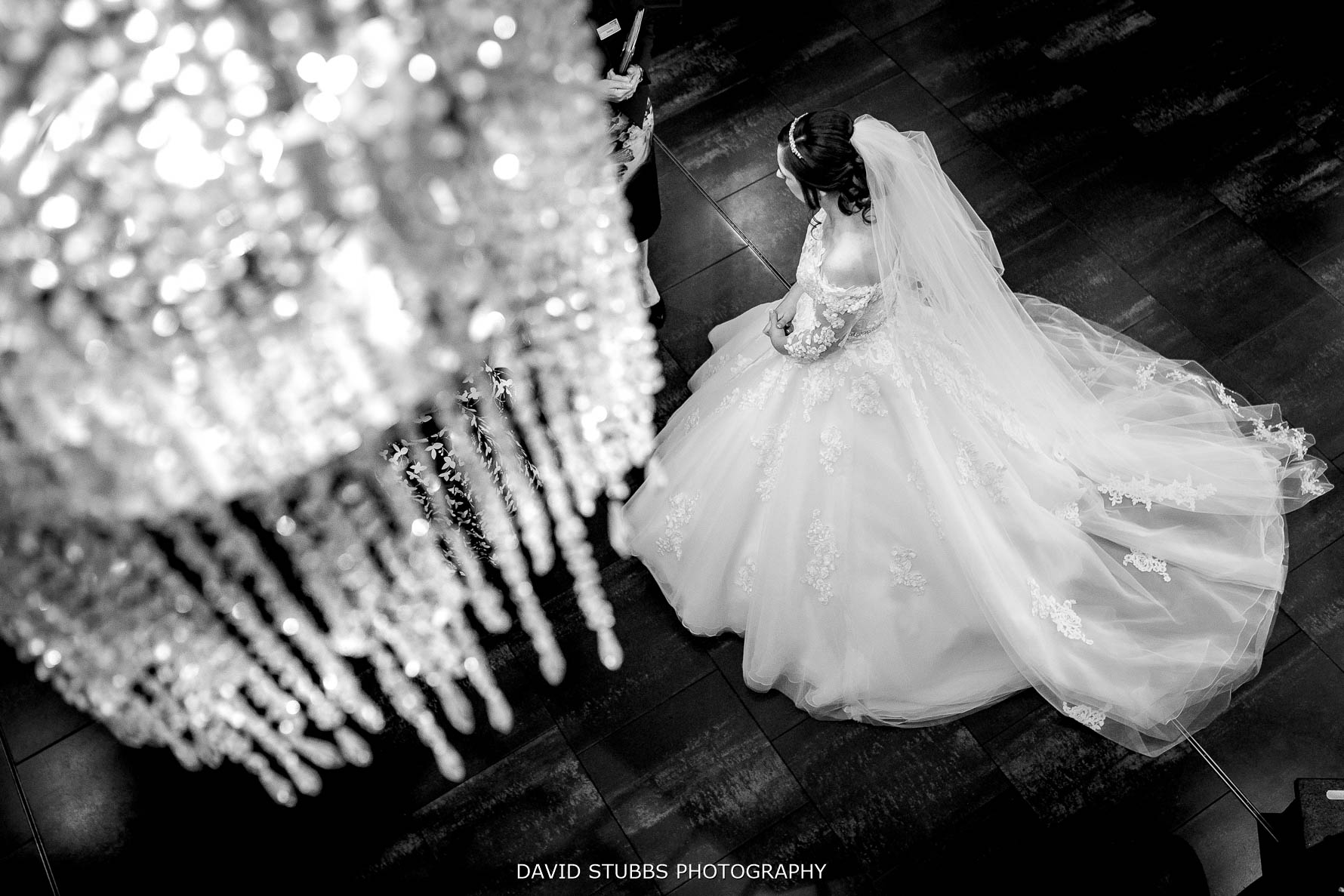 bride and wedding dress with Stanley house chandelier