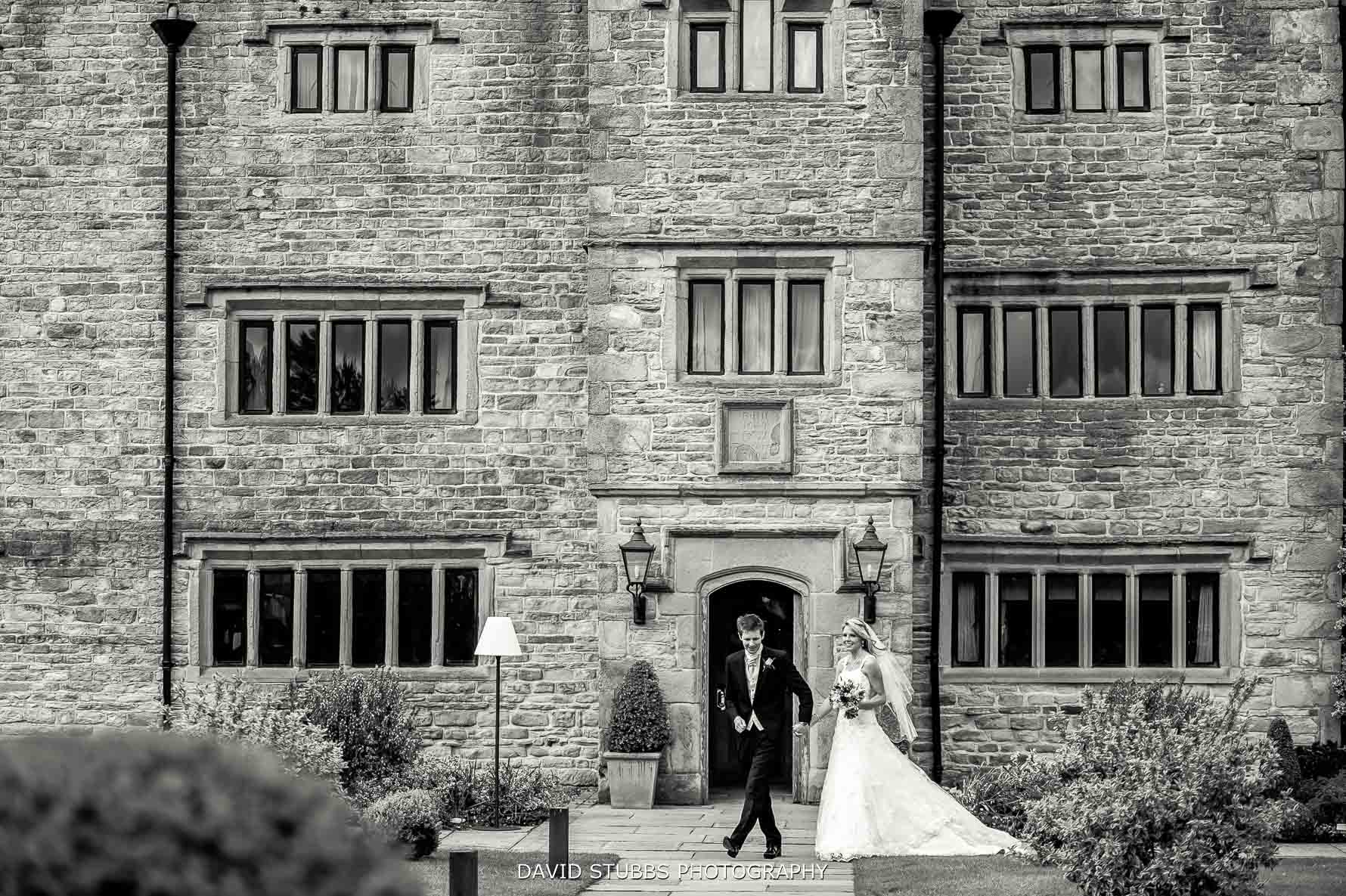 couple walking together in front of manor house