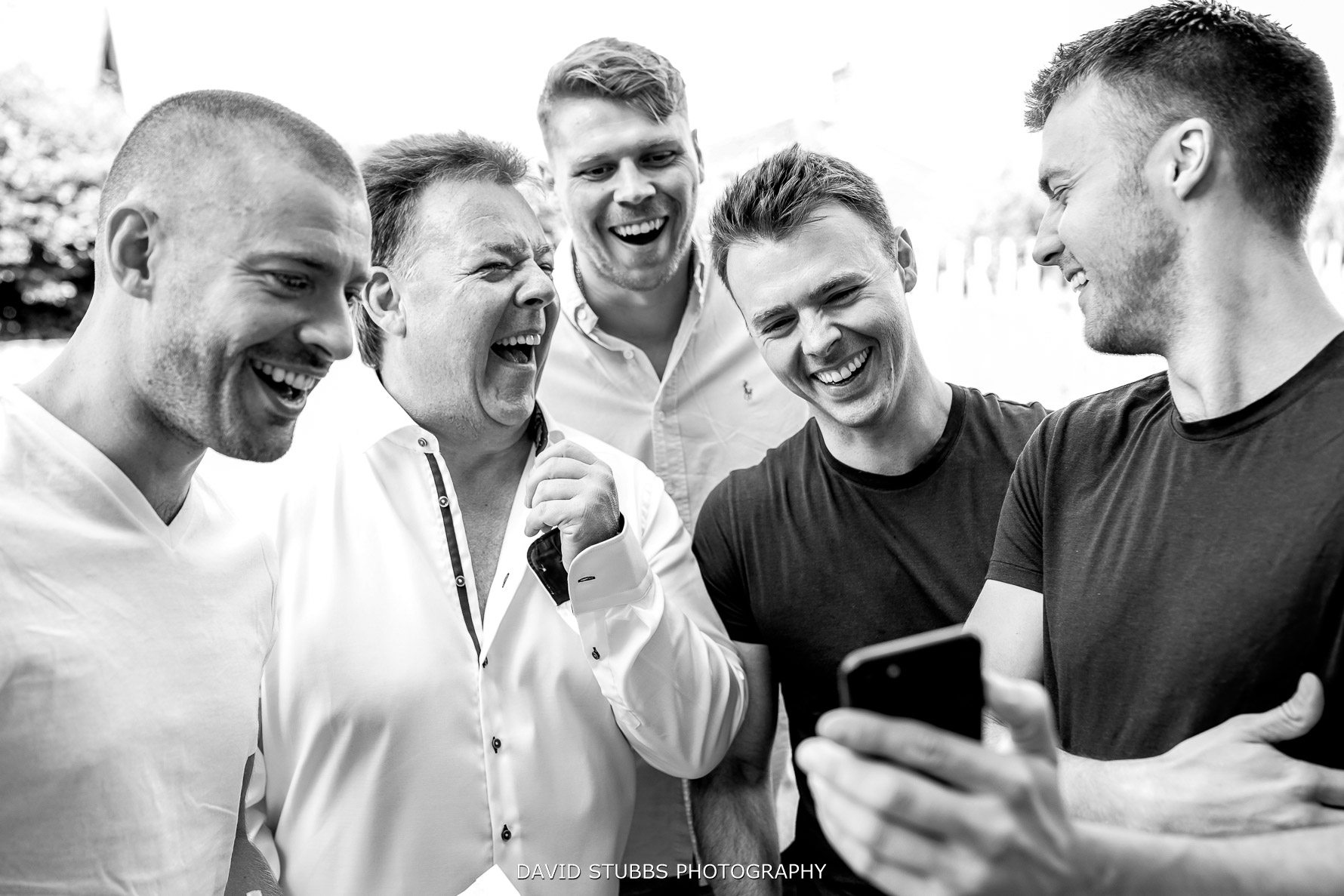 groomsmen having fun time morning of the wedding