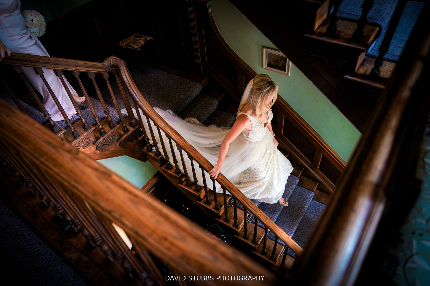 bride walking down the soughton hall stairs showing off her wedding dress