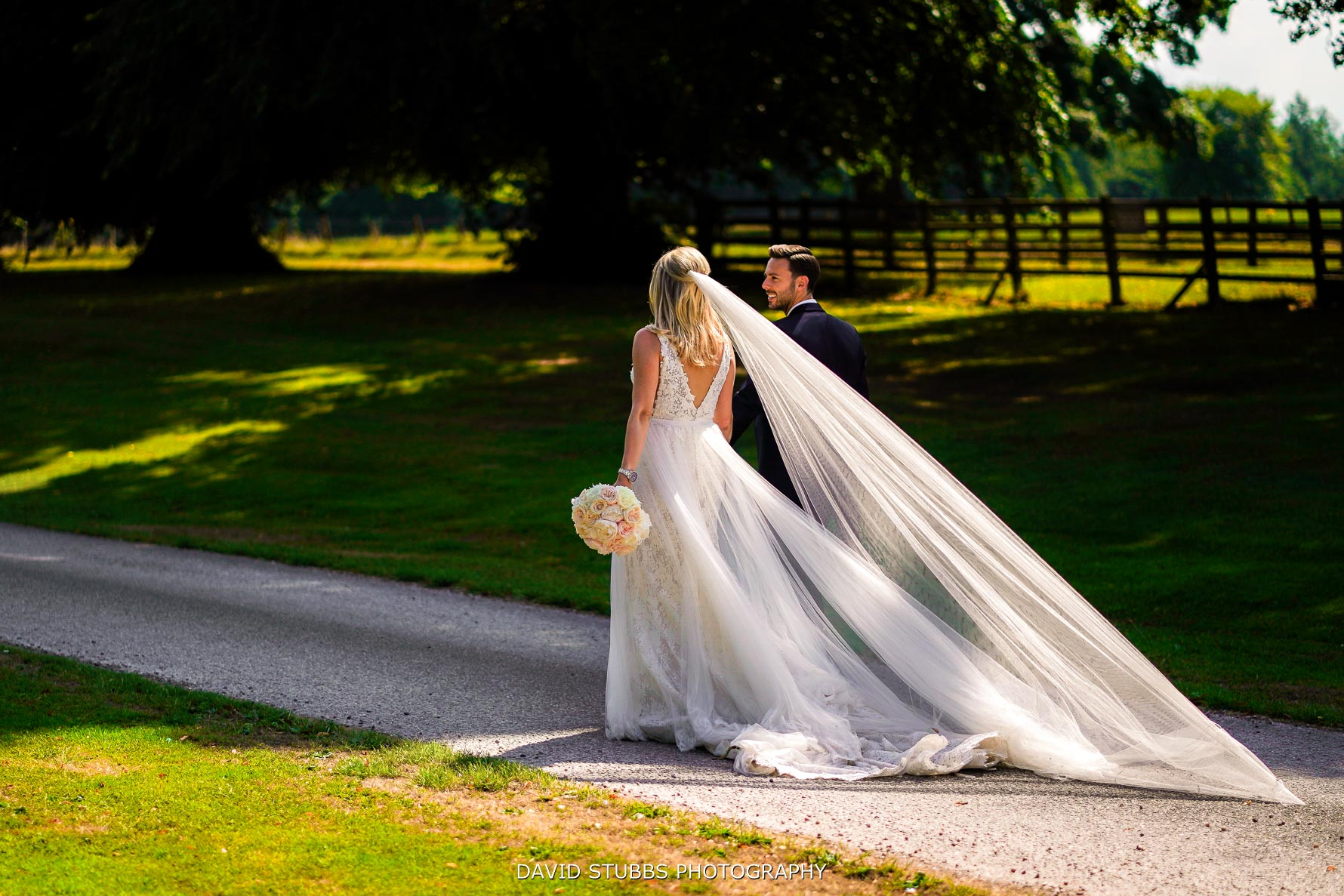veil and dress walking down the drive