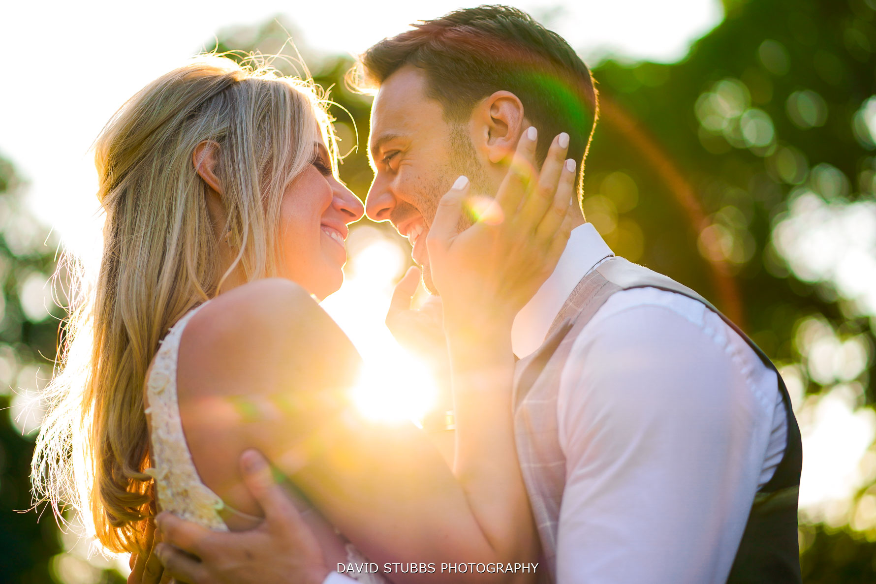 light and flare comingto the lens for this wedding photo