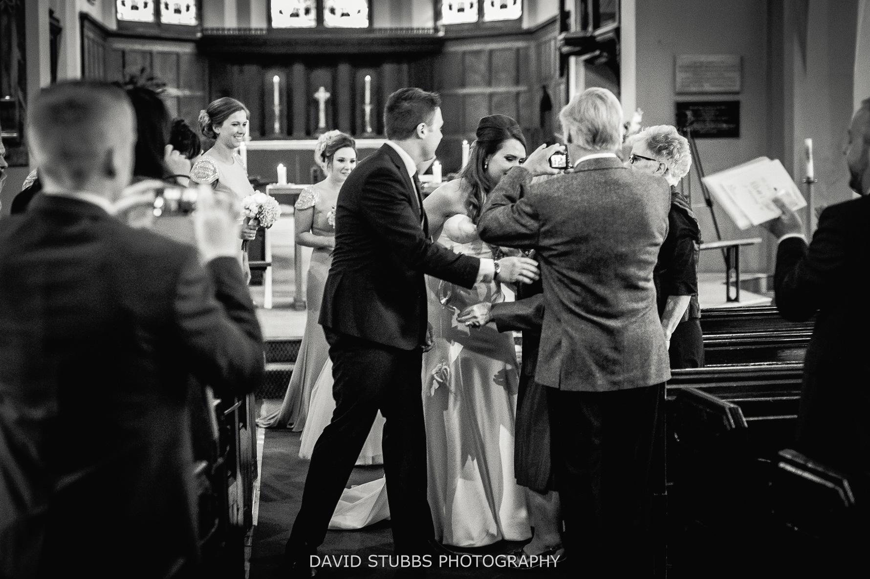 Bride & groom being congratulated by pride Gran