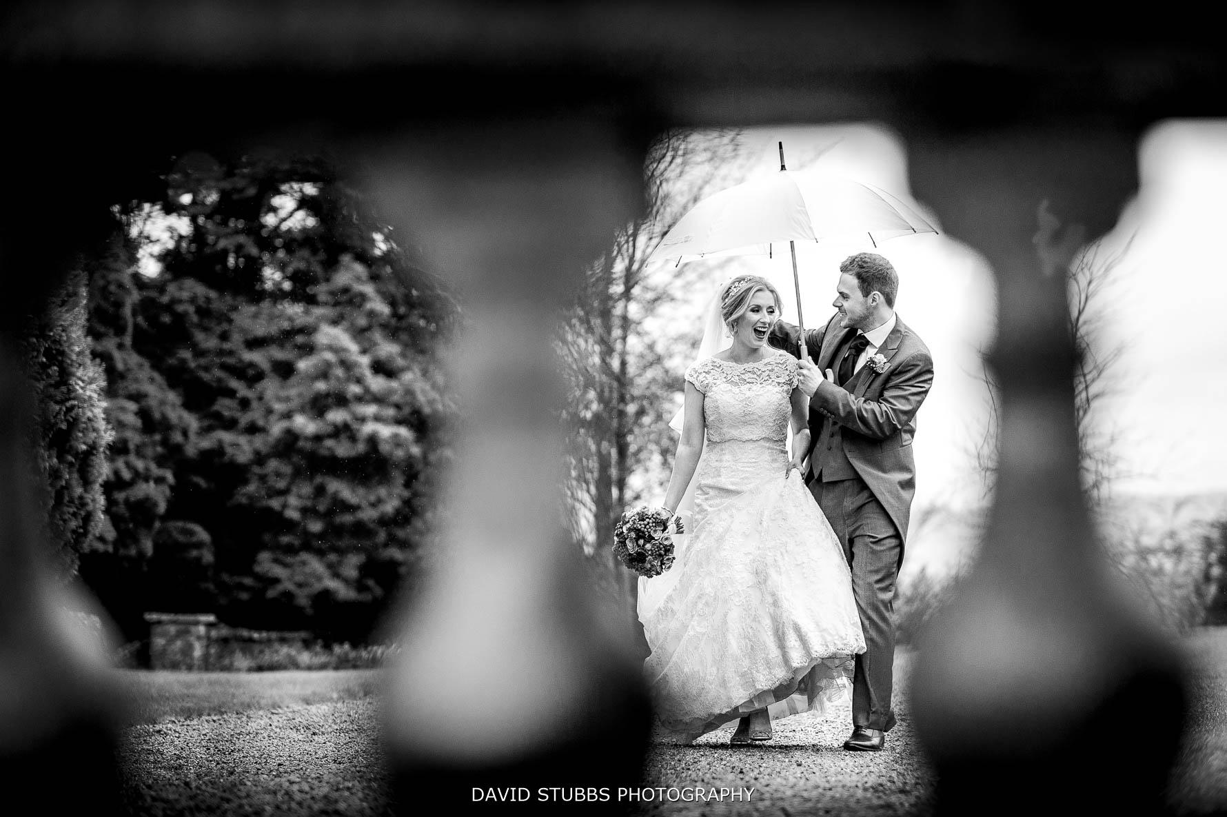 rain photo at eaves hall wedding
