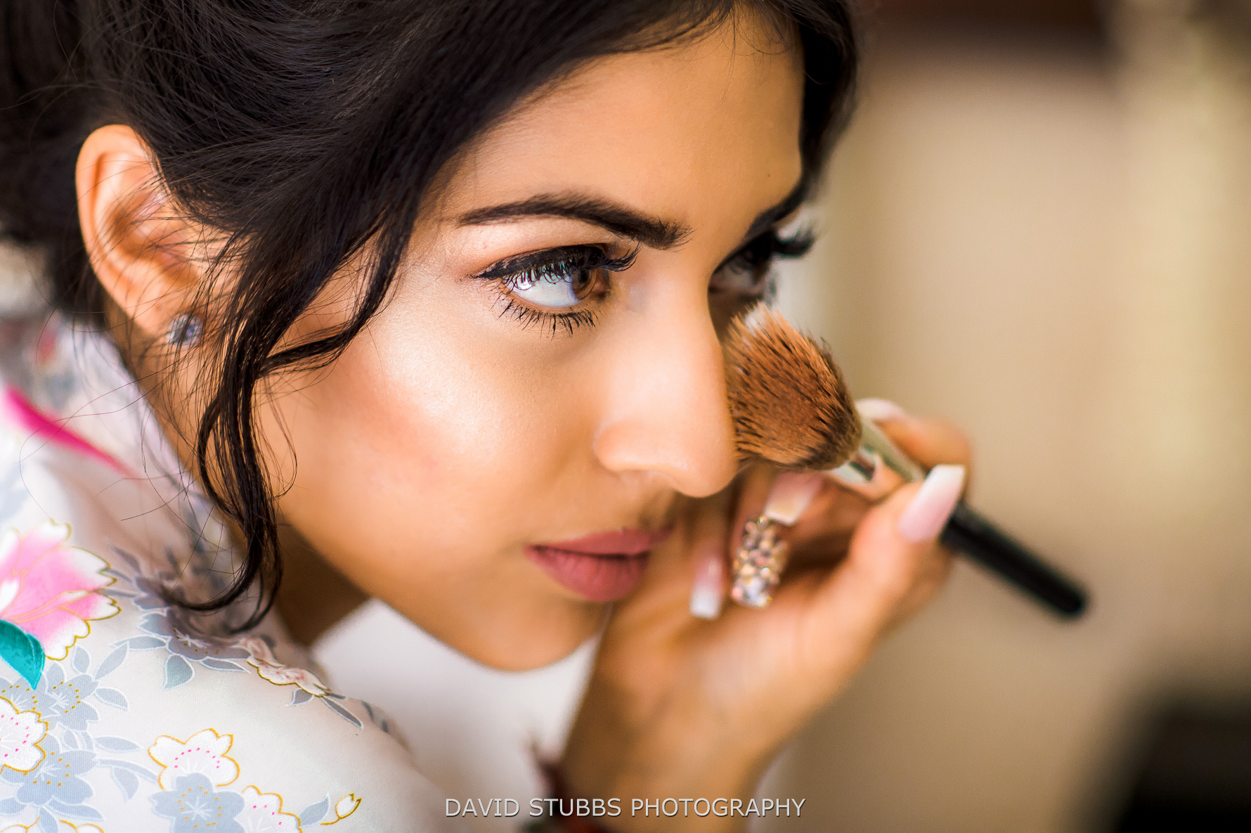 close up of bride doing her make-up