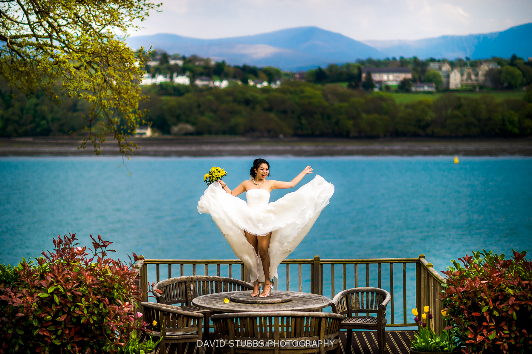 crazy wedding photo with menai strait
