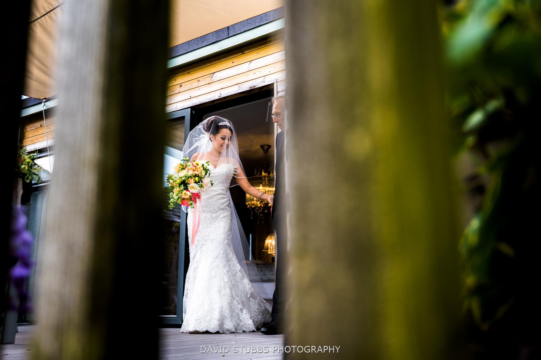 bride and dad shot through wood
