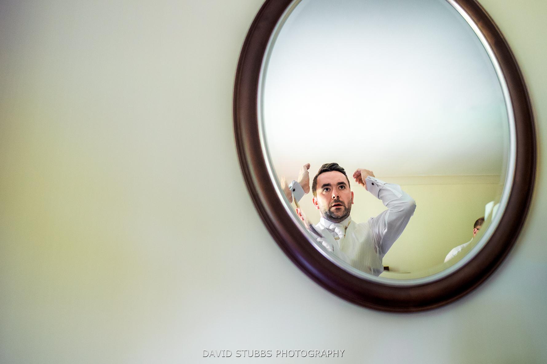 final preparations in mirror of hotel