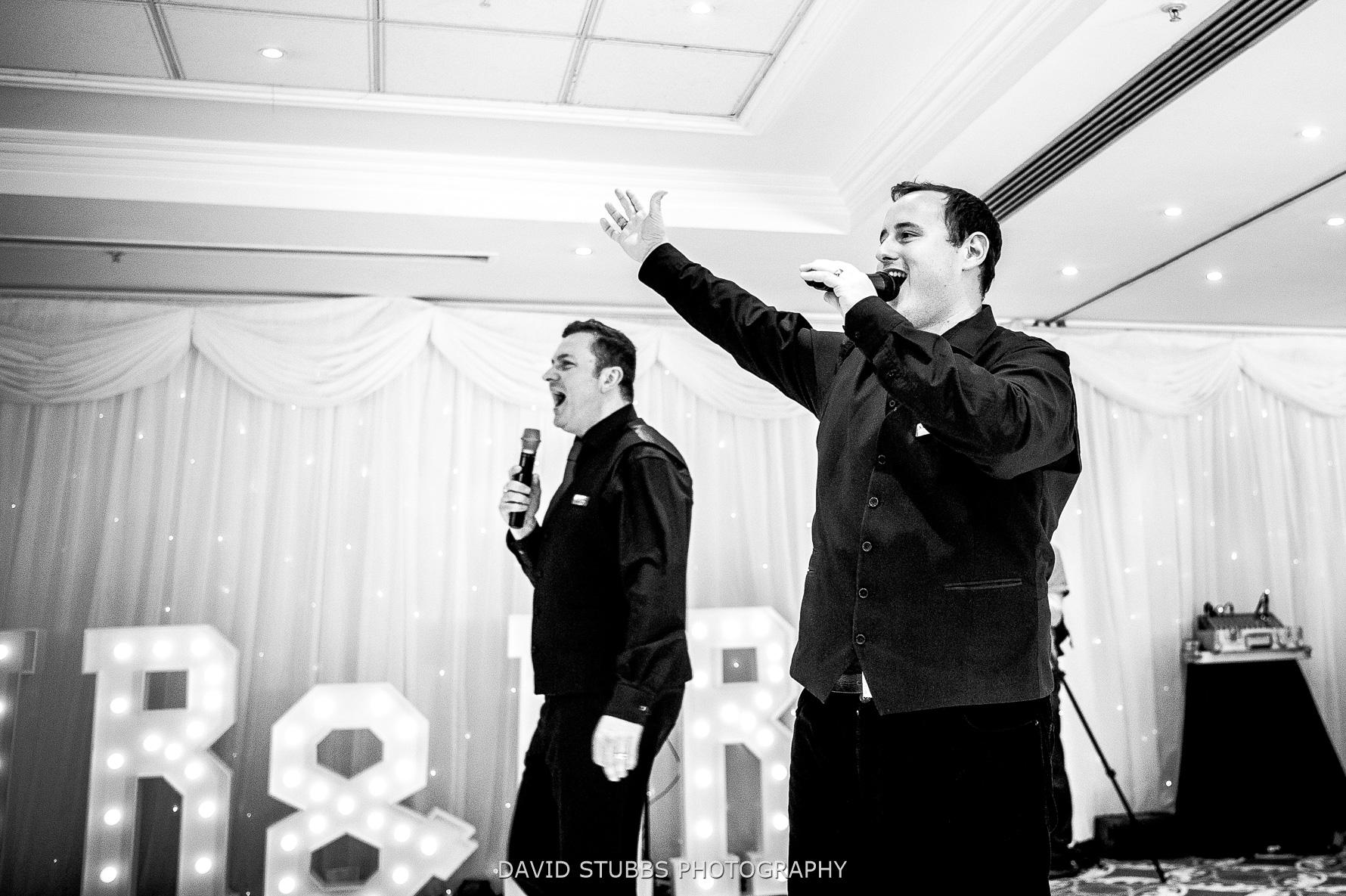 singing waiters enter hotel