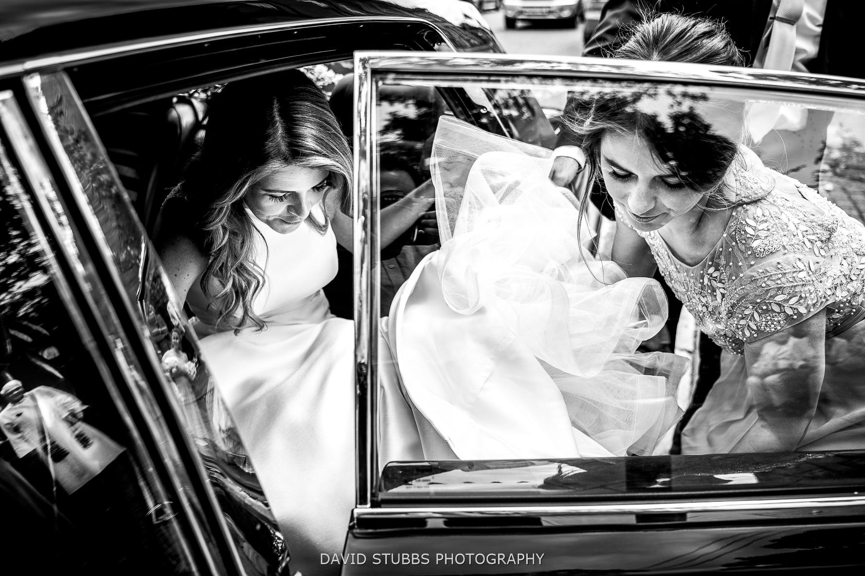 bride leaving wedding car