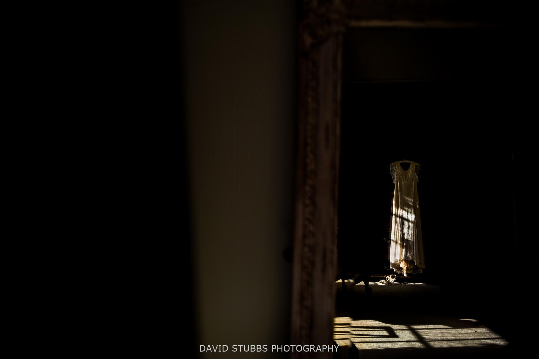 wedding dress in window light