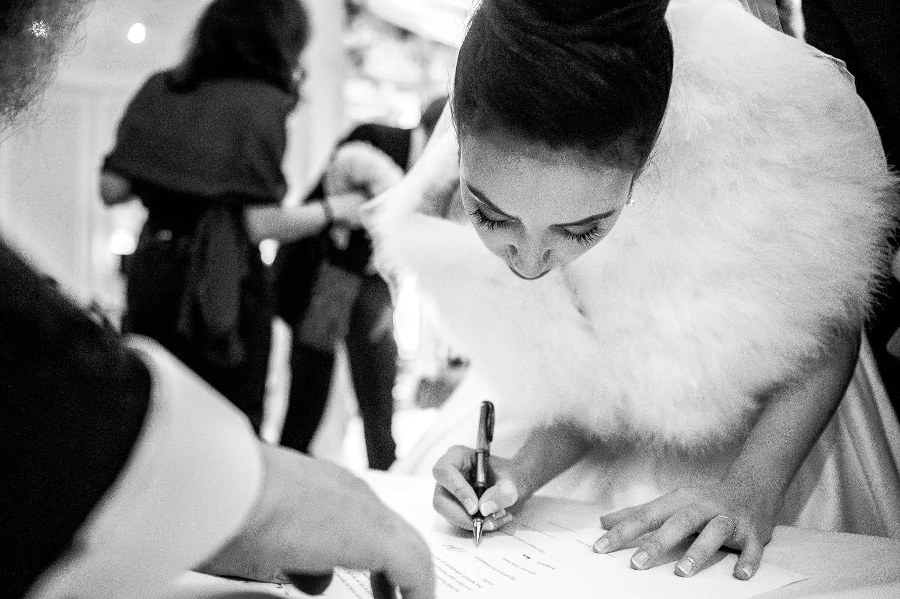 signing bride with rabbi