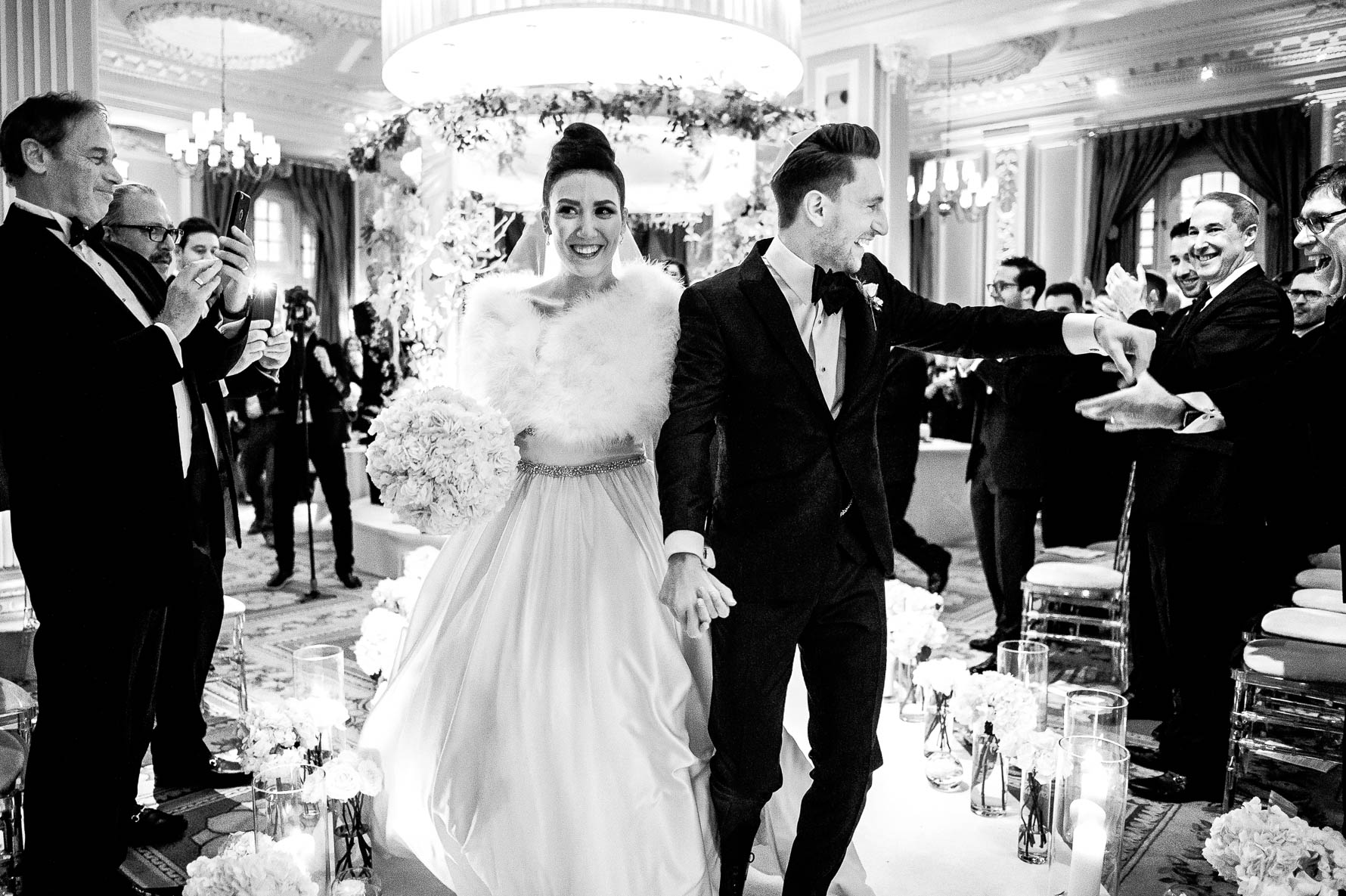 leaving wedding ceremony in black and white