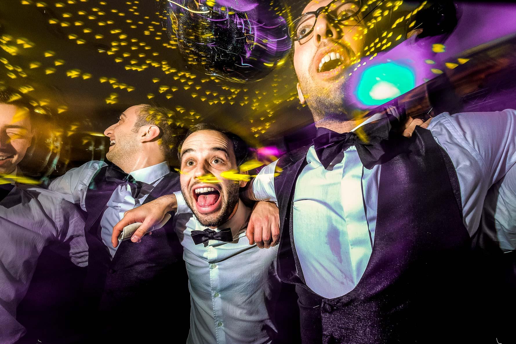 groomsmen in light confetti
