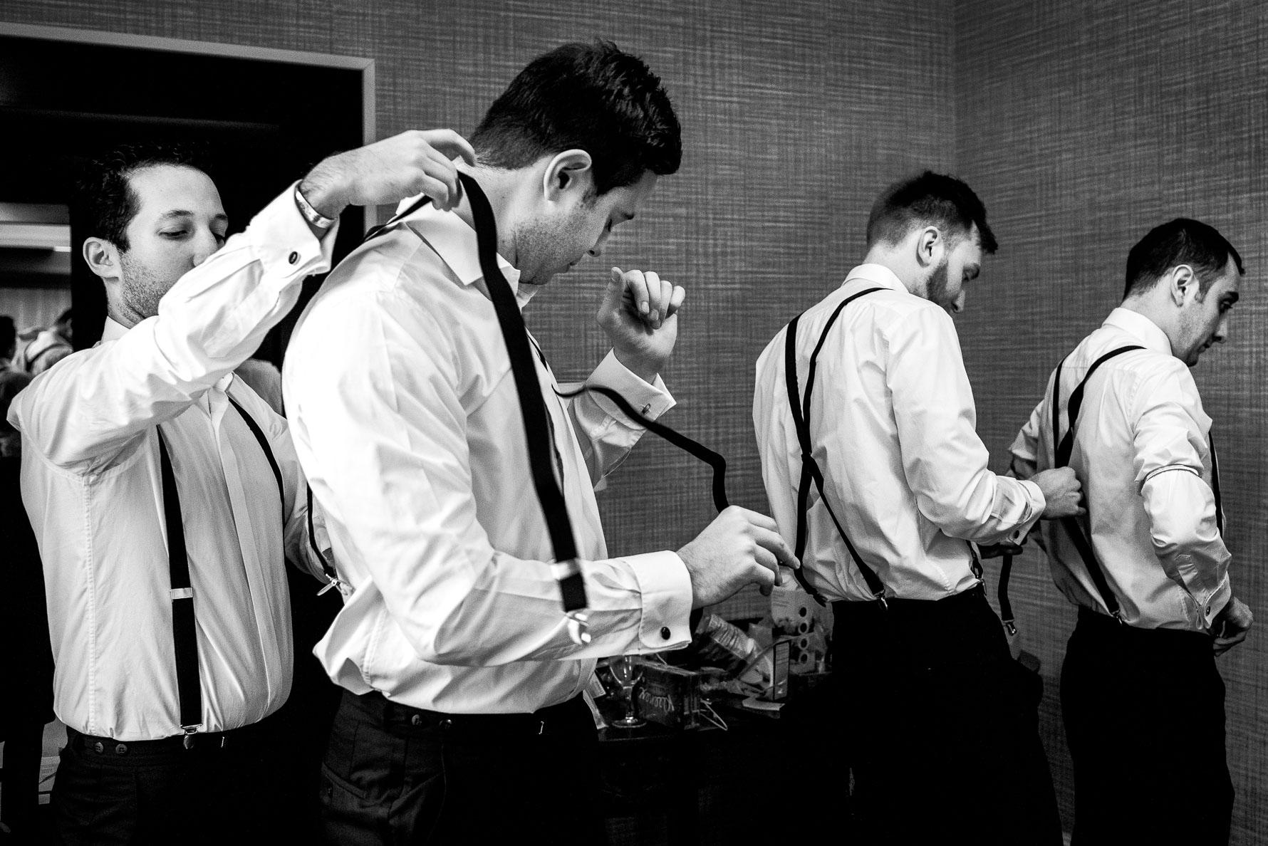 groomsmen getting ties and suits on