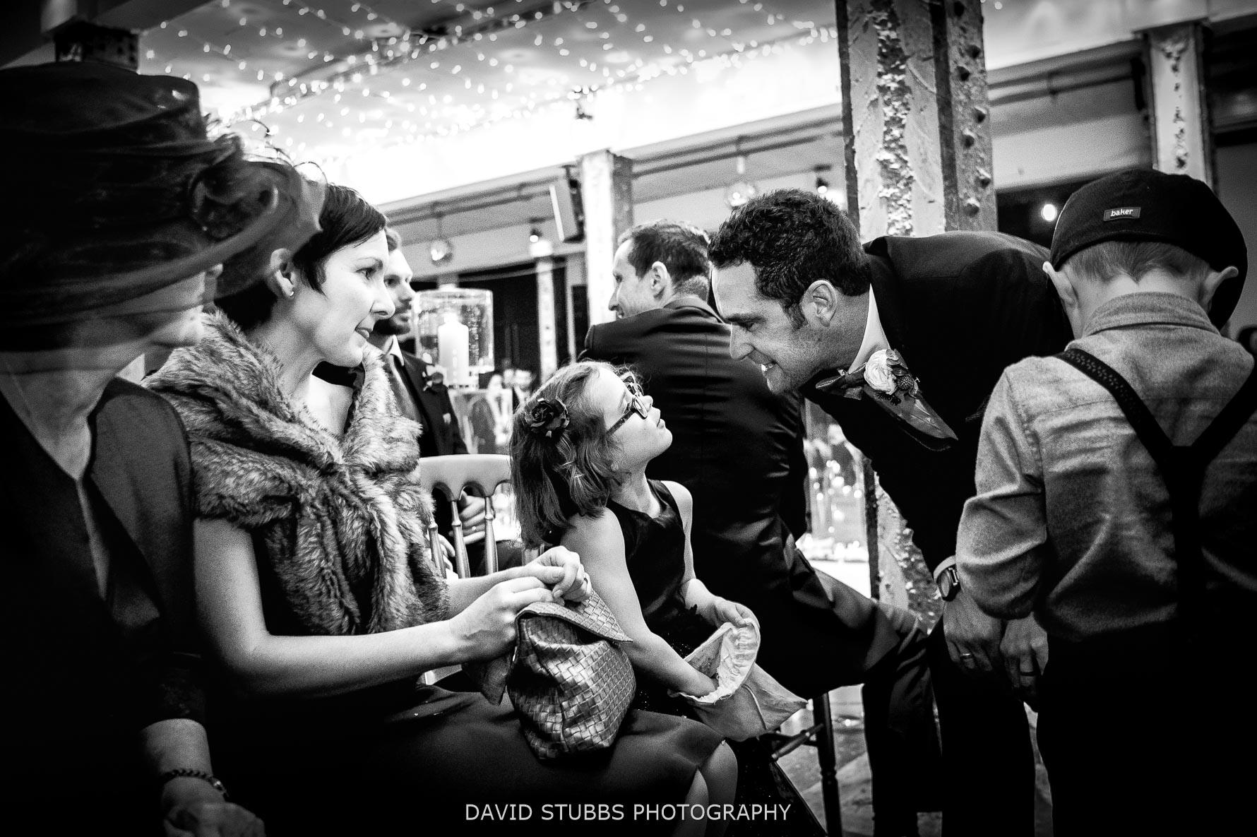 groom seeing flower girl