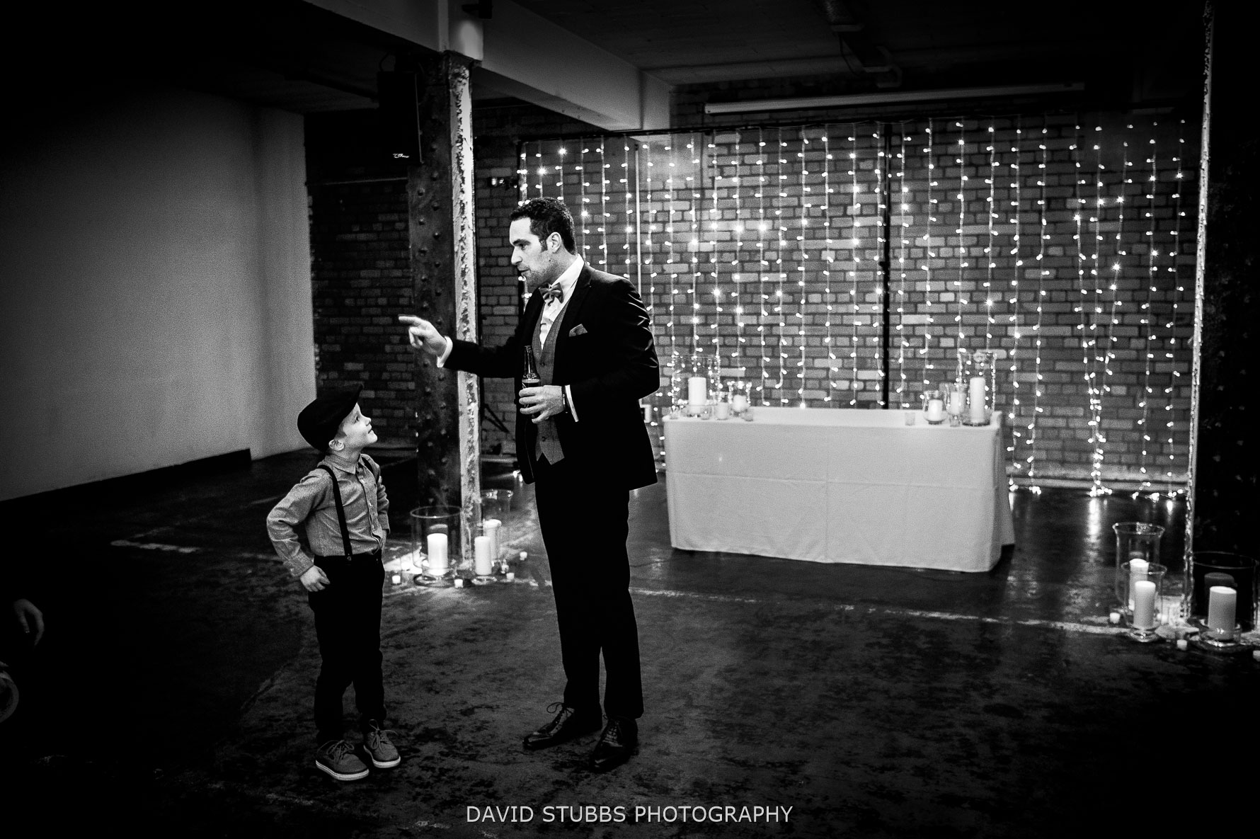 page boy and groom in black and white