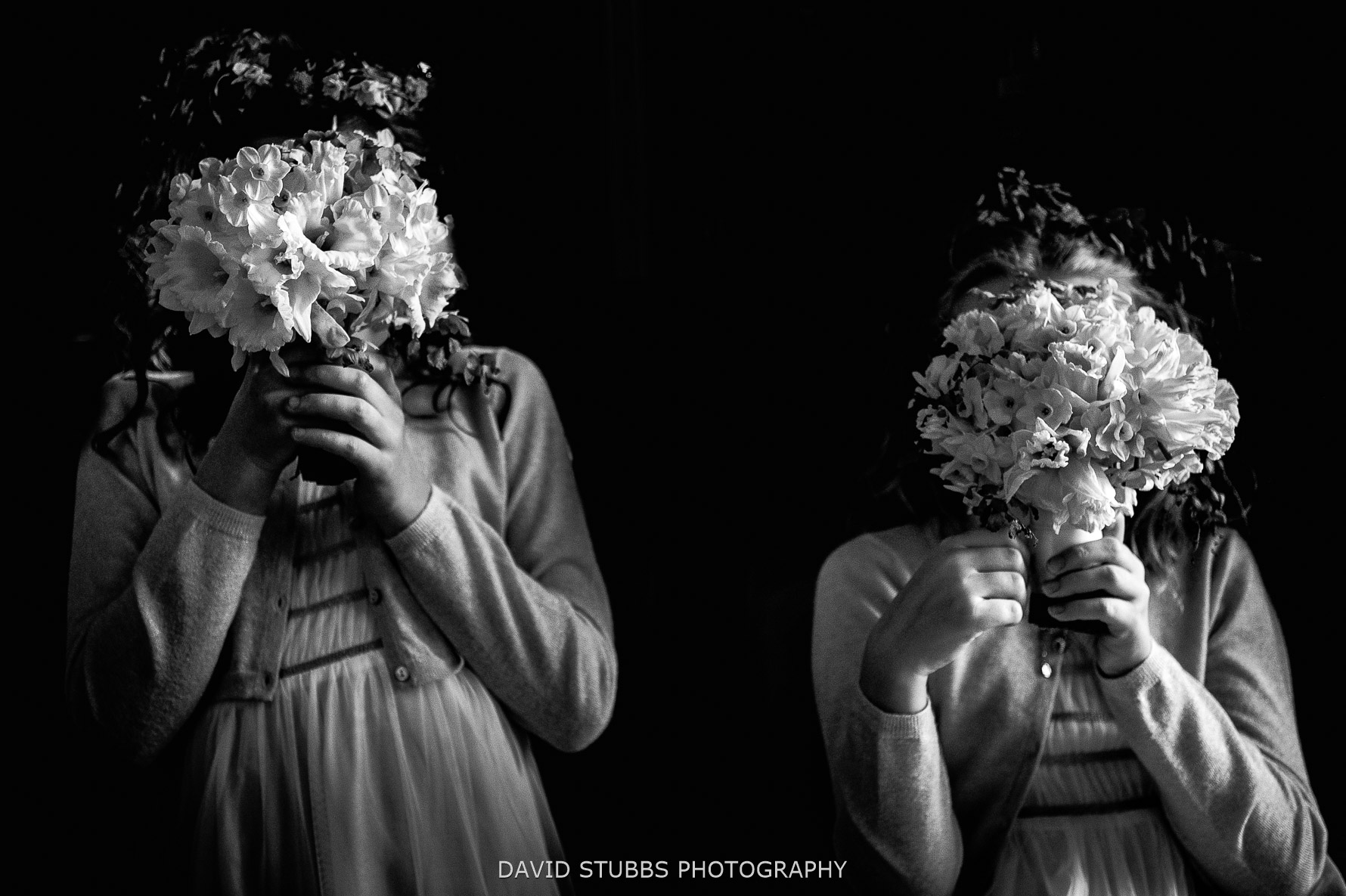flowers in front of faces