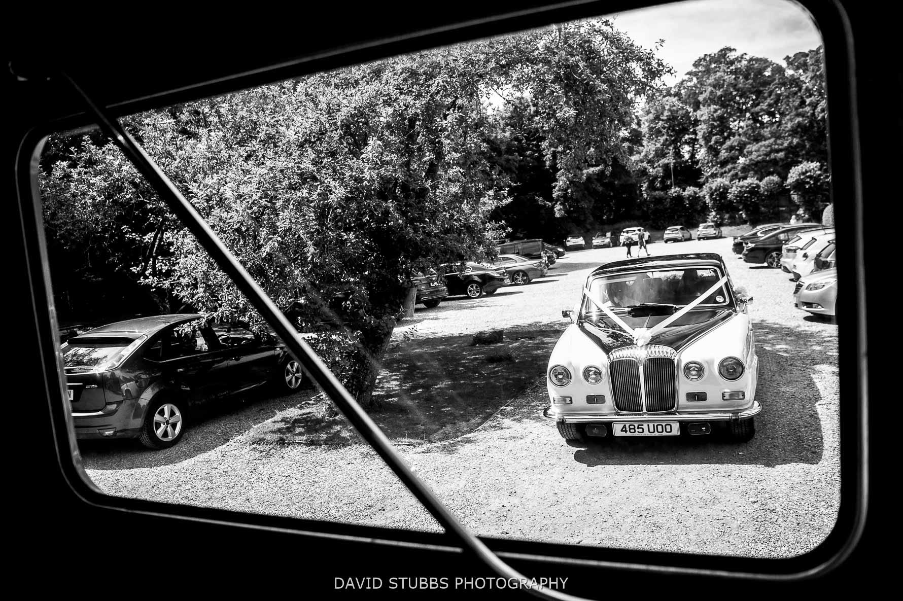 vintage wedding car behind