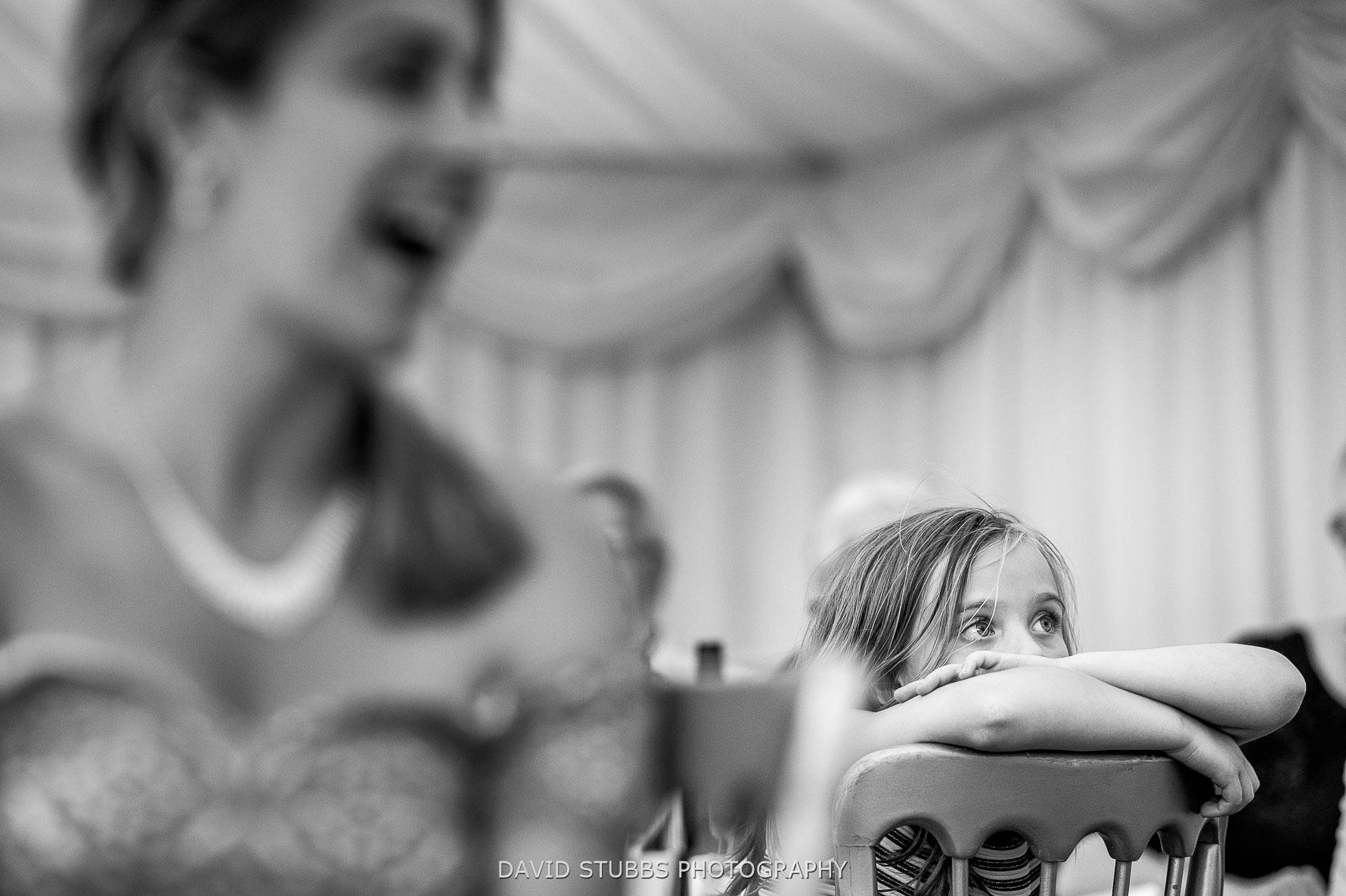 kid bored during wedding speeches