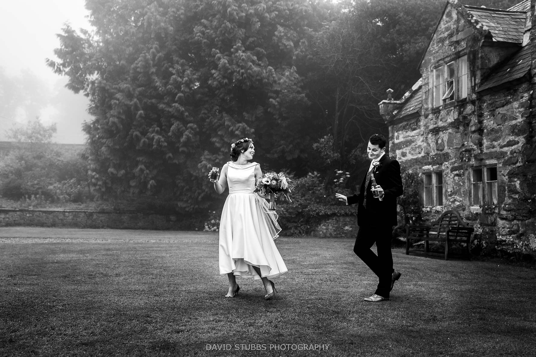walking across the lawn of the hall