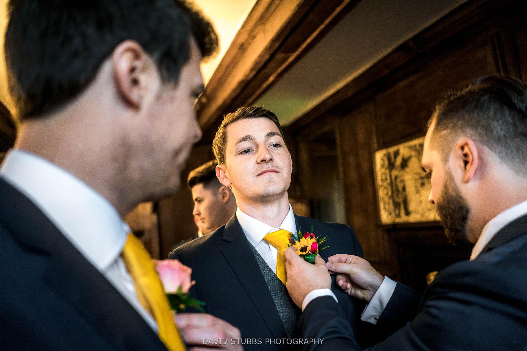 groom matt getting his suit on