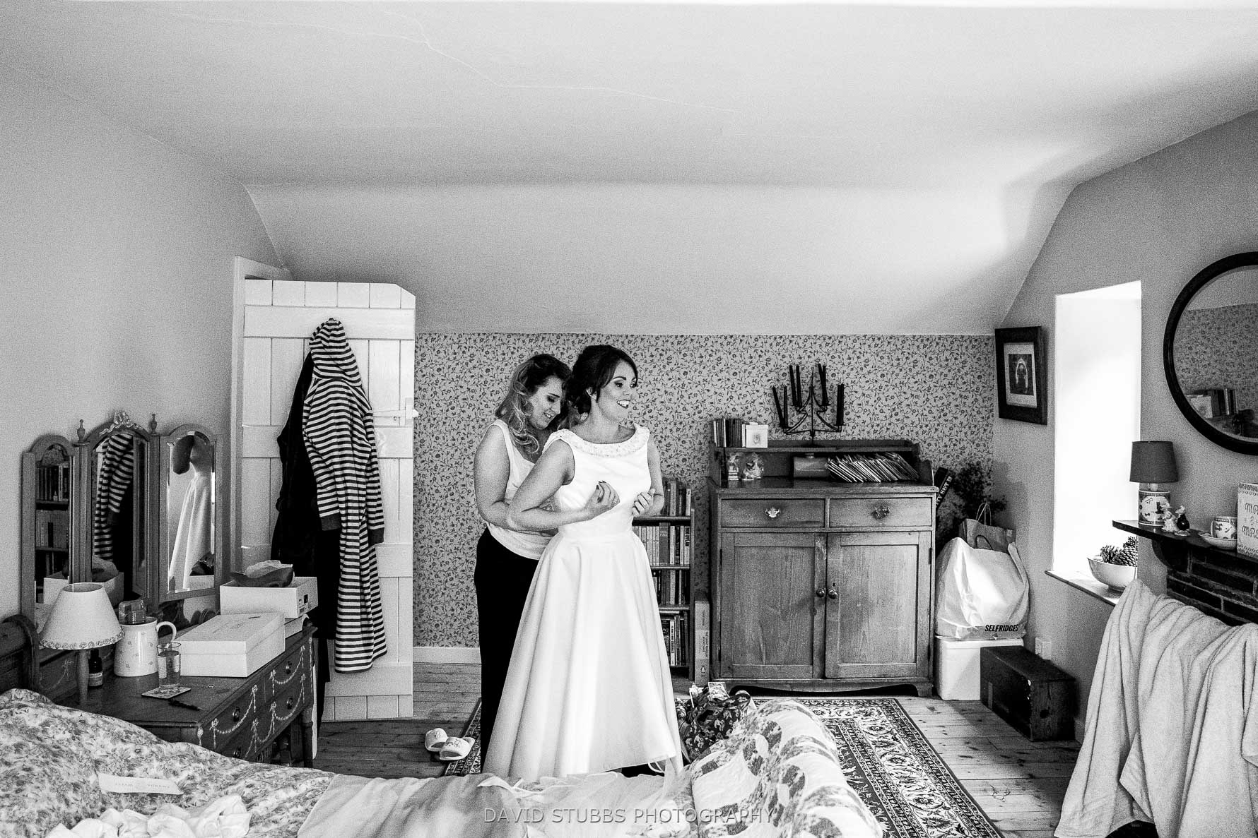 getting her wedding dress on before ceremony