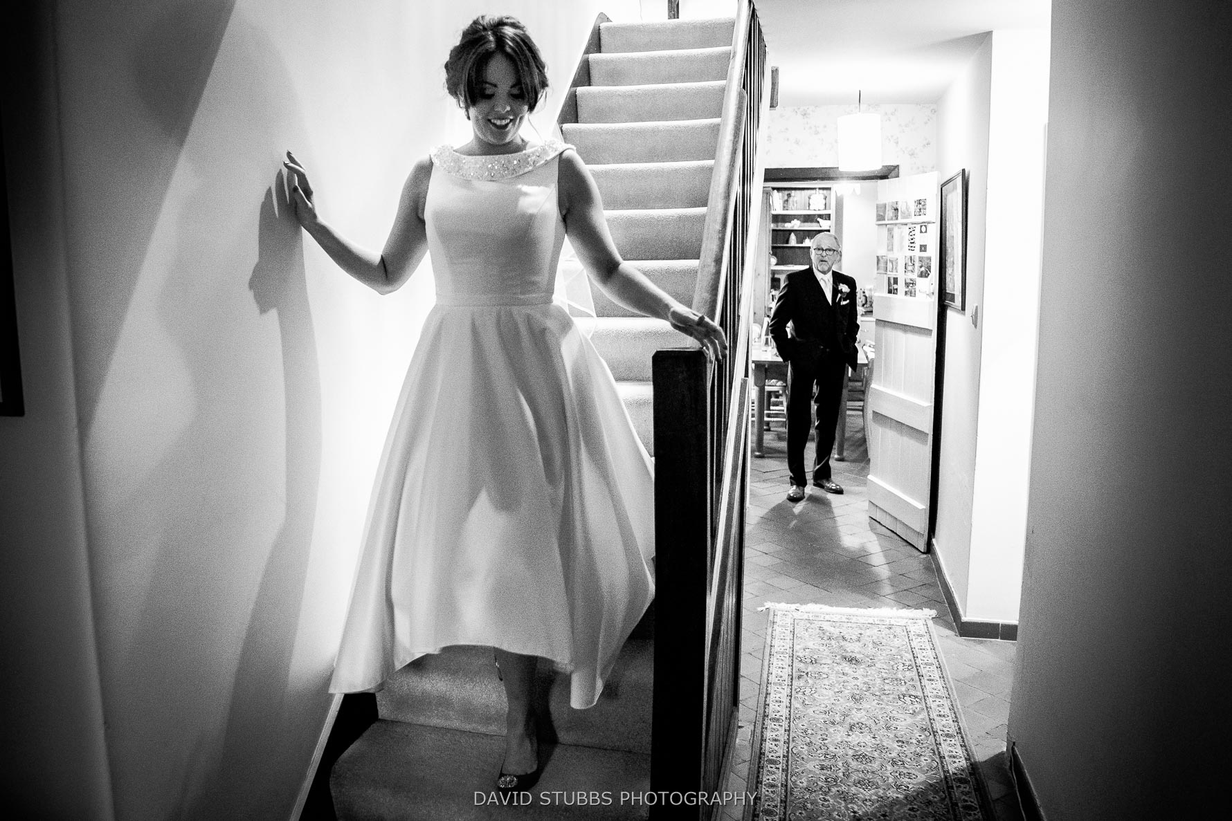 coming down the stairs to see father of the bride