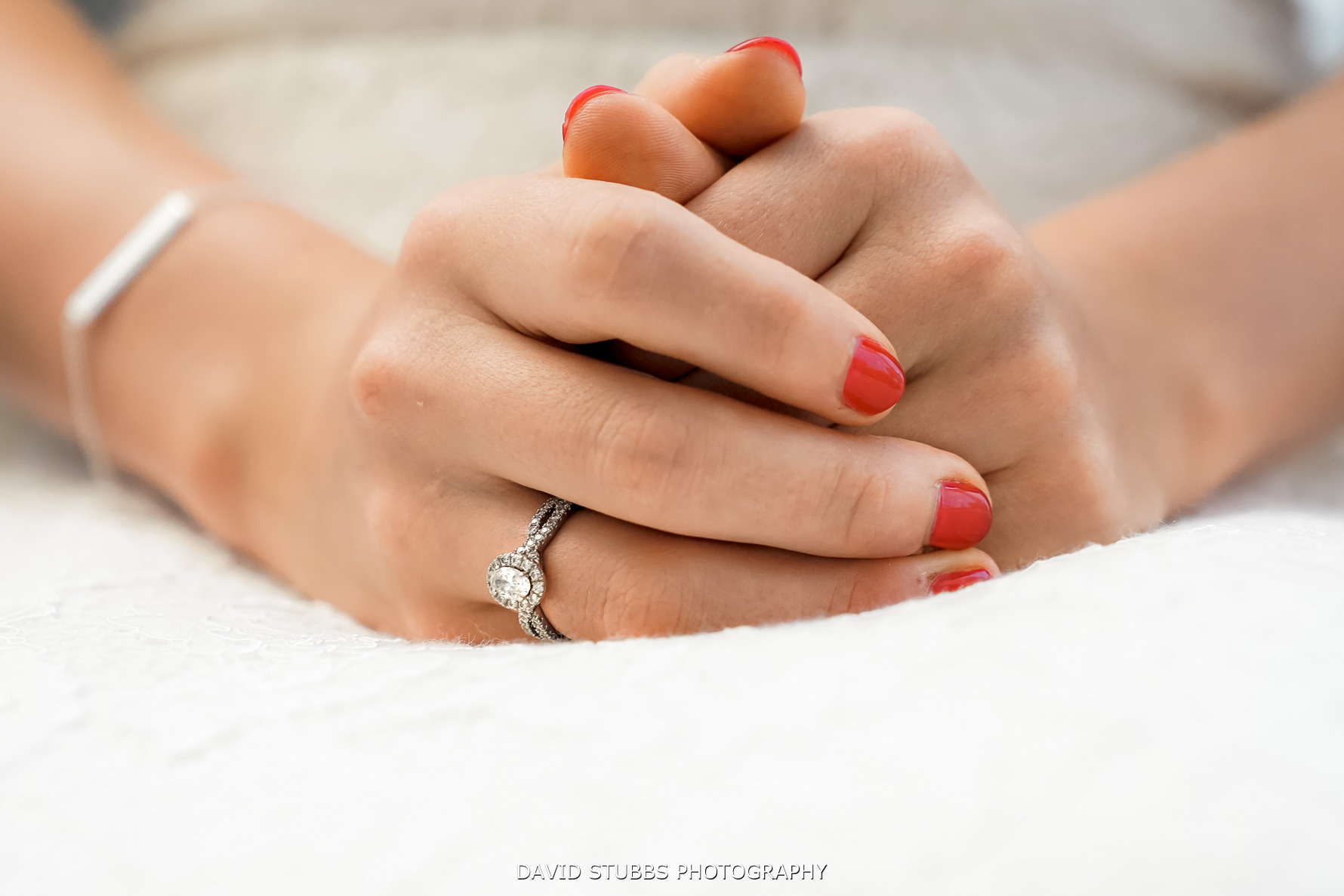 close-up photo of brides hands and wedding ring