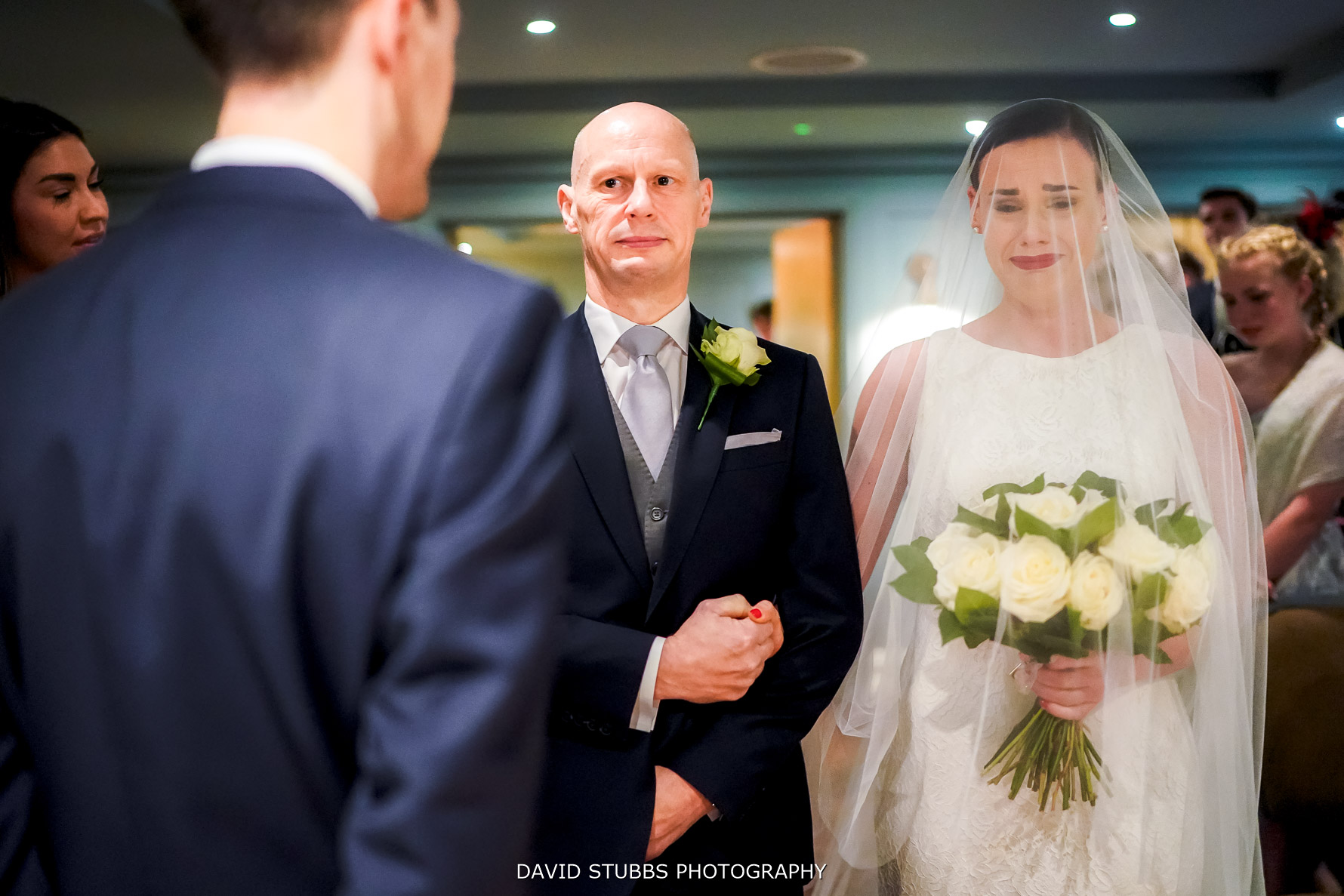 walking ddown the isle with her dad