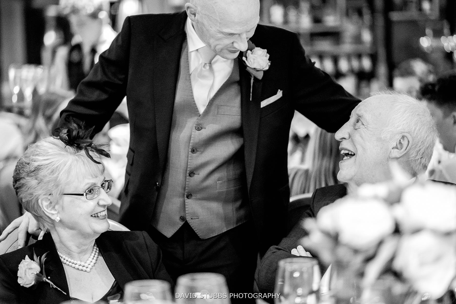 dad speaking to wedding guests