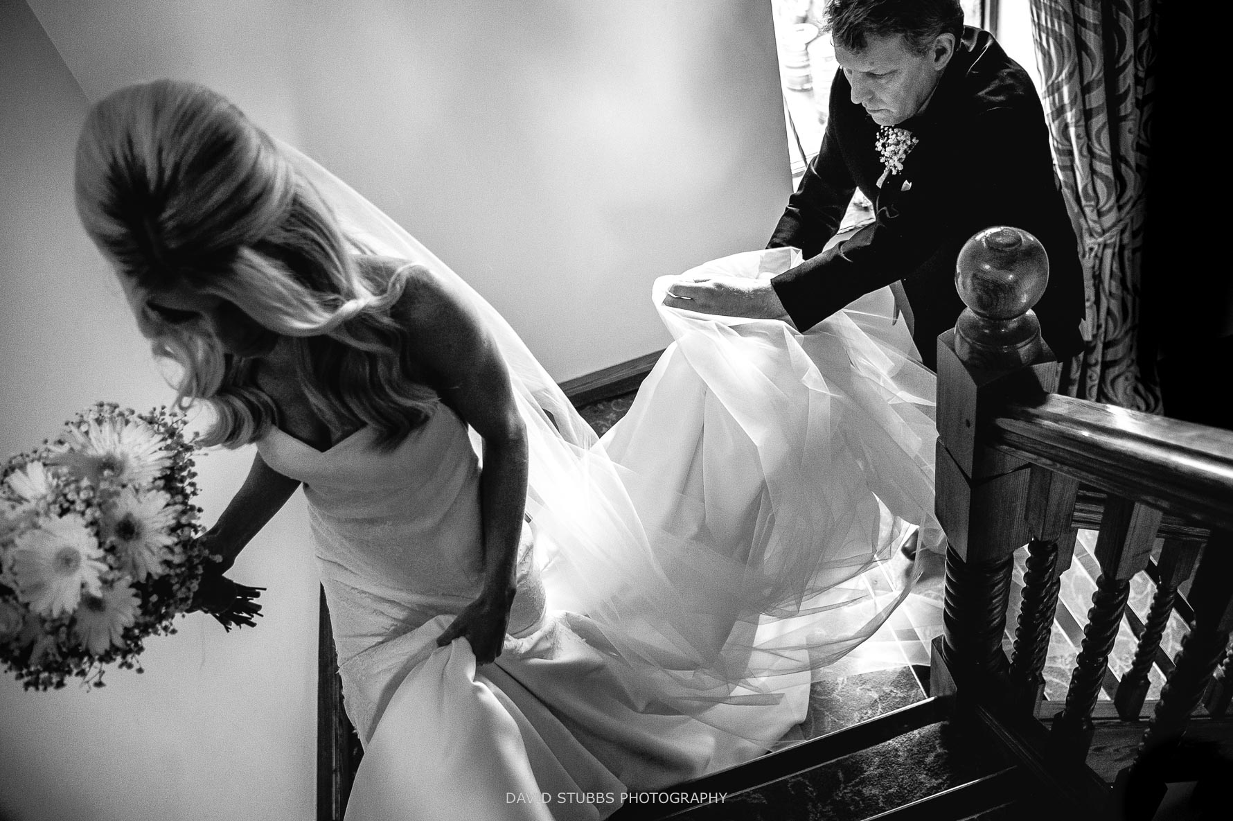 lifting the dress up the stairs