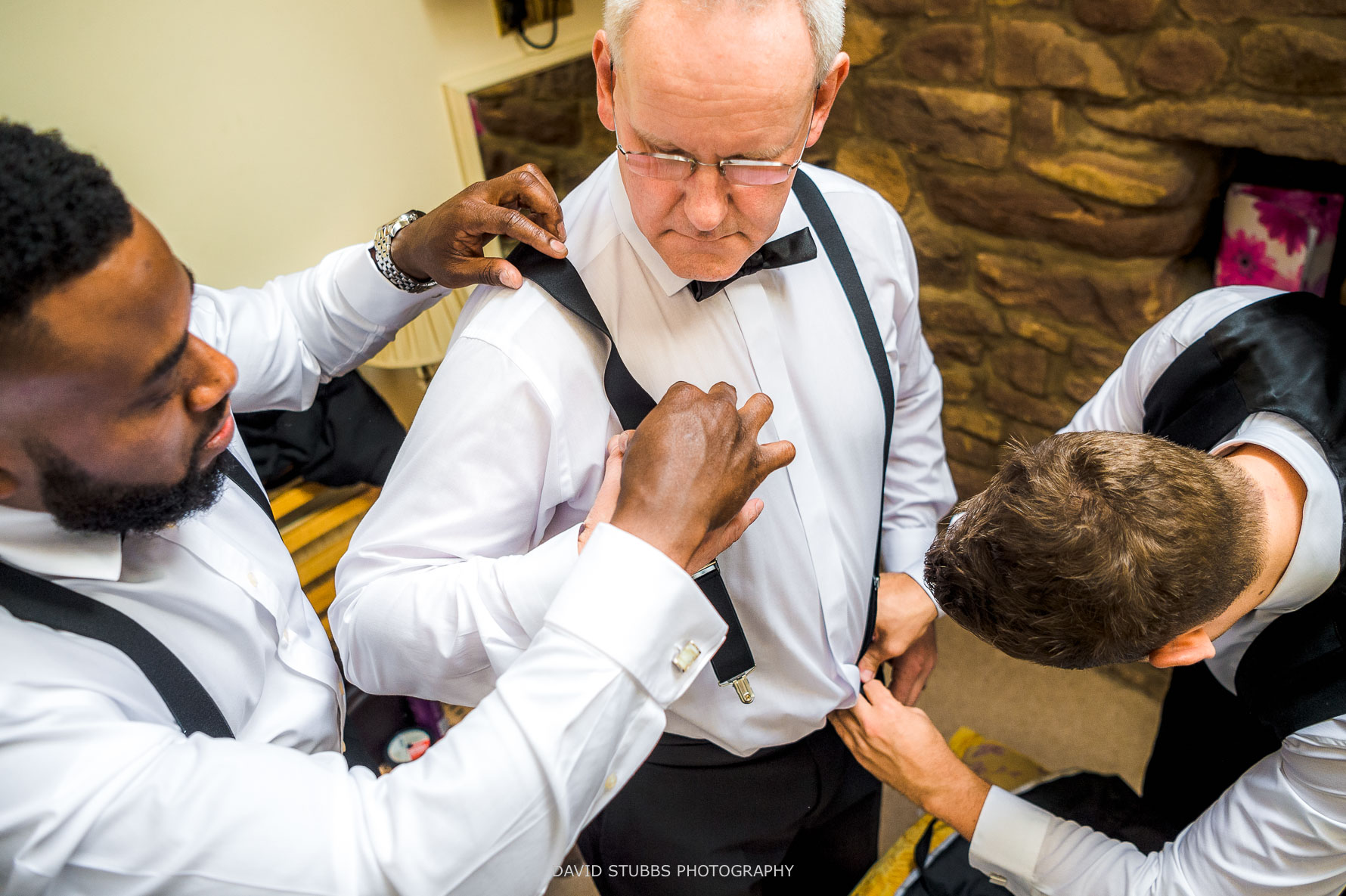 father of the groom getting ready before wedding